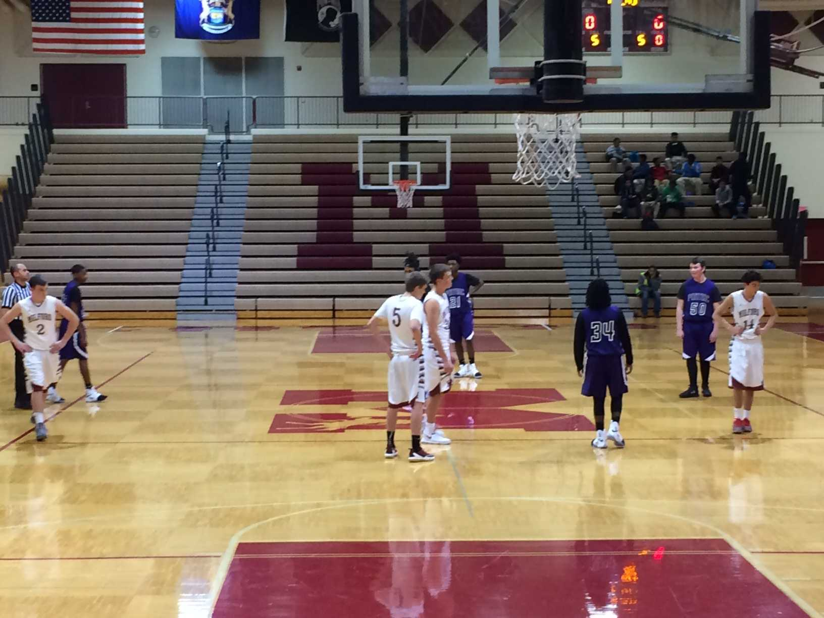 The Milford JV basketball team starts off with only four players on the court in their first home game, leaving a spot open in honor of Cole.