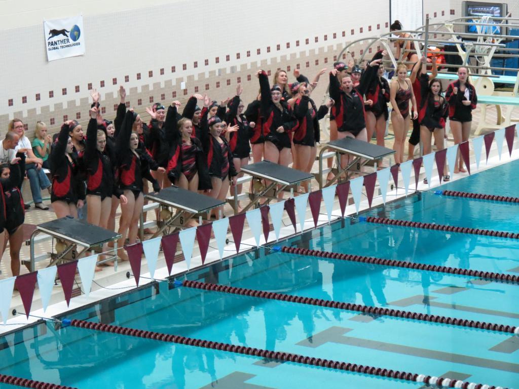 "Milford Girls' Swim Team: ""One Big, Happy Family"""