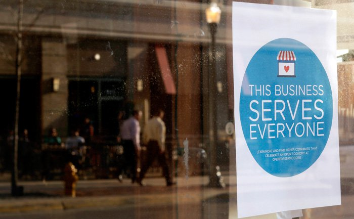 Signs are being put in business windows to show that they serve everyone