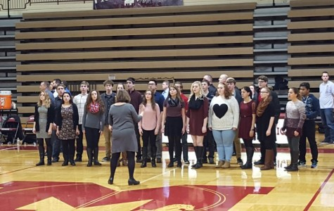 Lakeland student section sings over National Anthem at basketball game