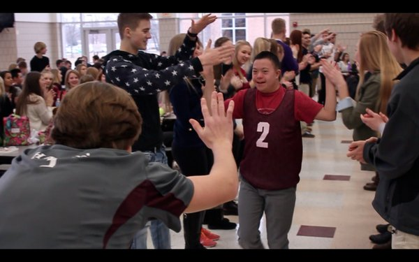 Calvin high fives with other MHS students during last Saturday's Special Olympics Events