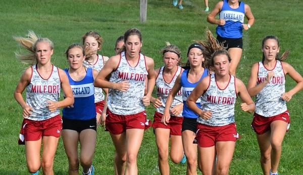 Girls cross country team running against Lakeland.