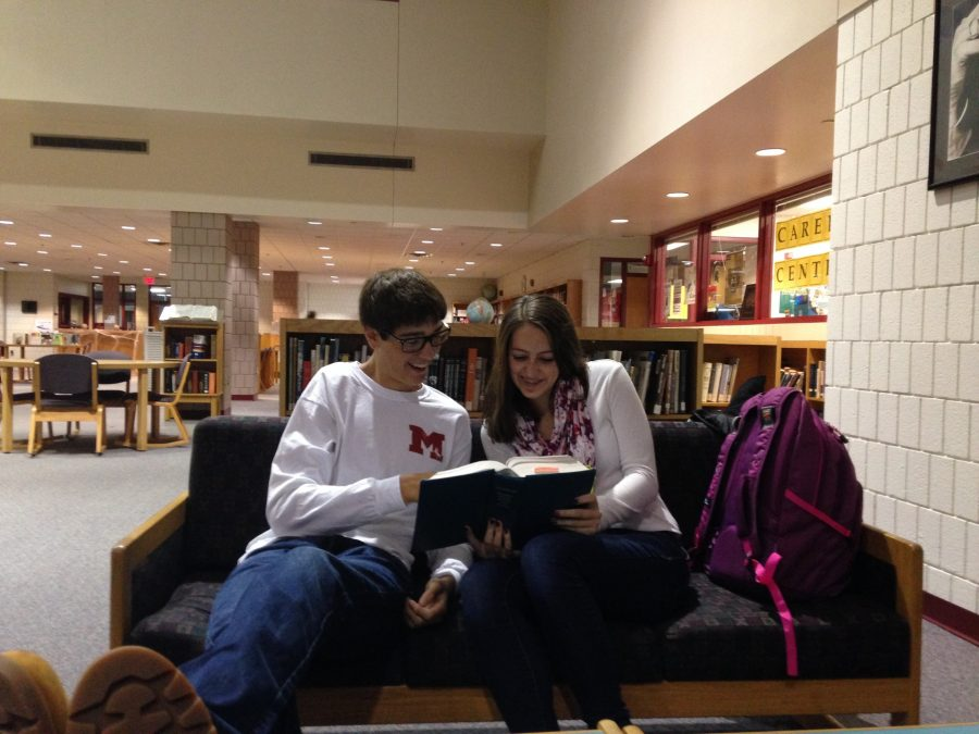 Reid Sellers and Julia Schwendenmann studying in the library.
