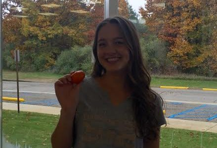 Senior, Claire Sysko, poses with her favorite snack.