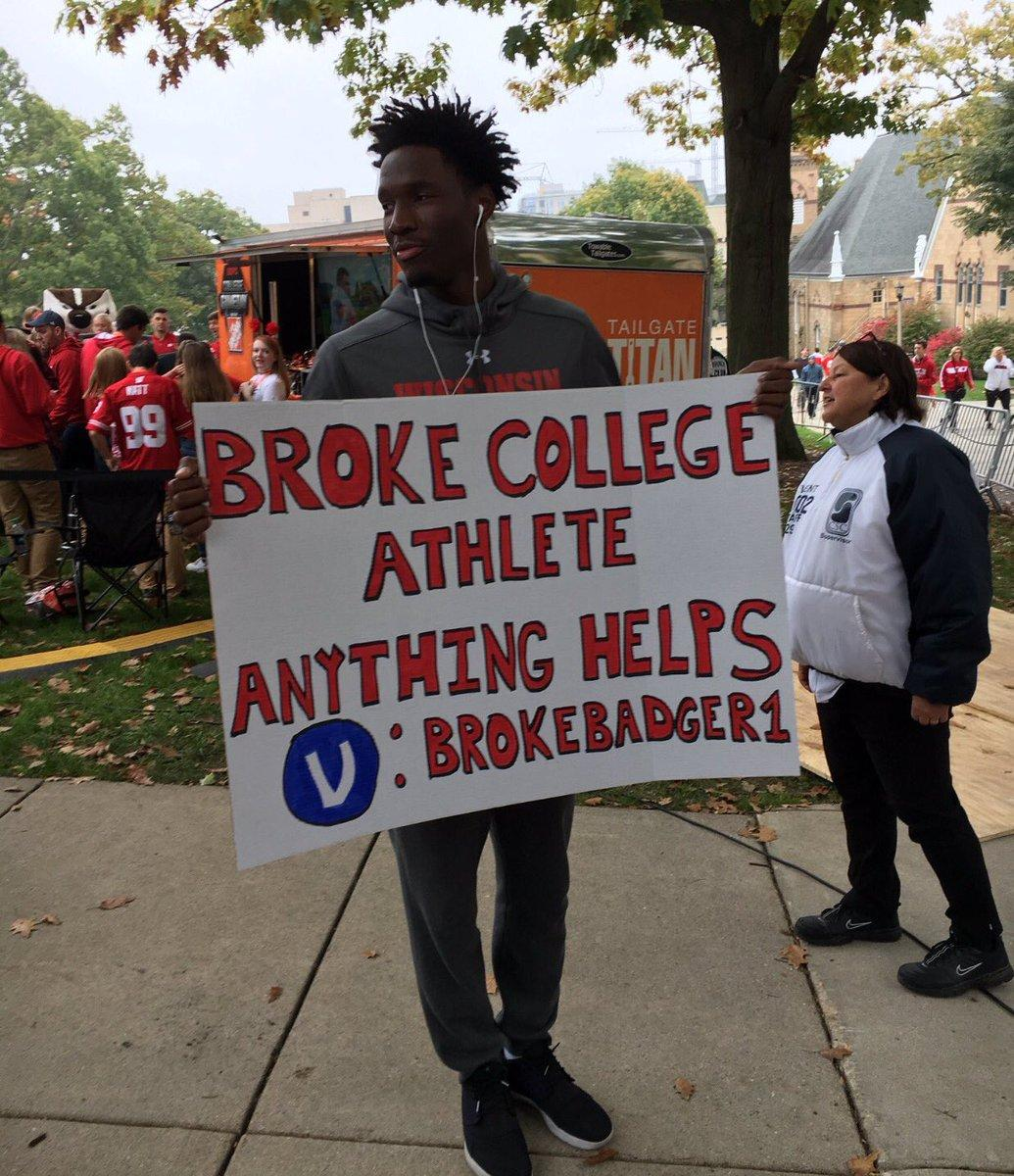 Nigel Hayes, a University of Wisconsin basketball player, holds a sign protesting the NCAA at College Gameday.