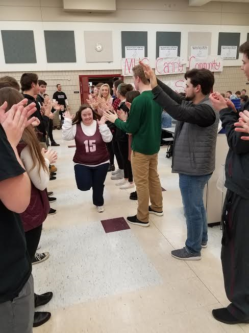 Special Olympians bring energy, applause to the Milford Fieldhouse