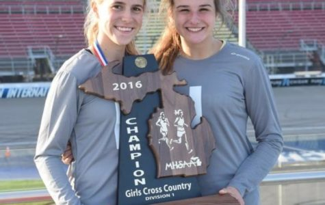 Victoria Heiligenthal and Nicole Grindling proudly holding the state championship trophy.
