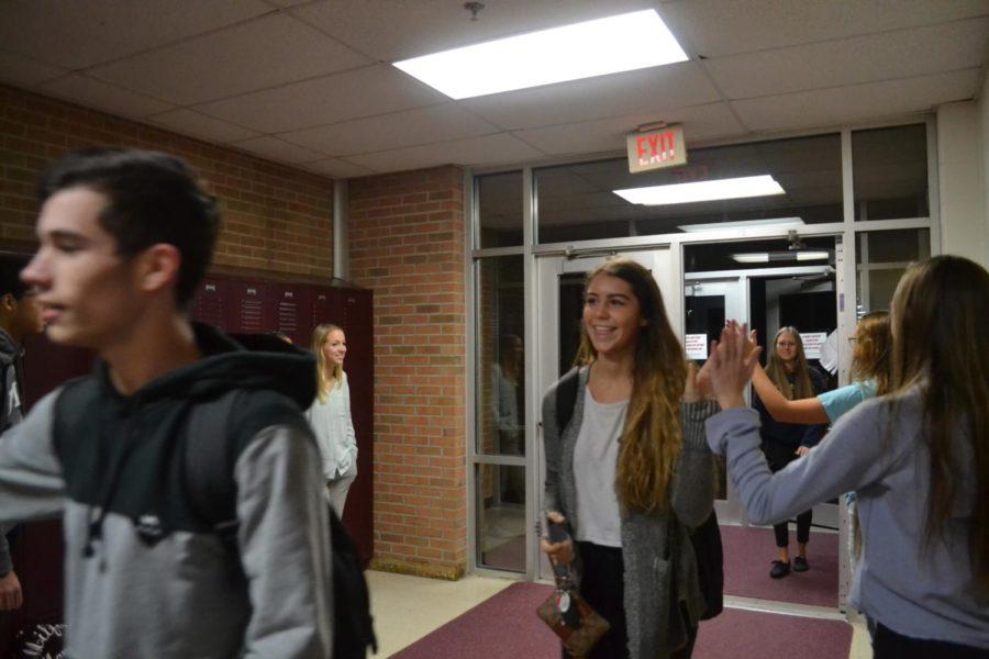 Juniors+Sabrina+Sajdak+and+Abby+Spindler+greeted+at+student+parking+lot+entrance.