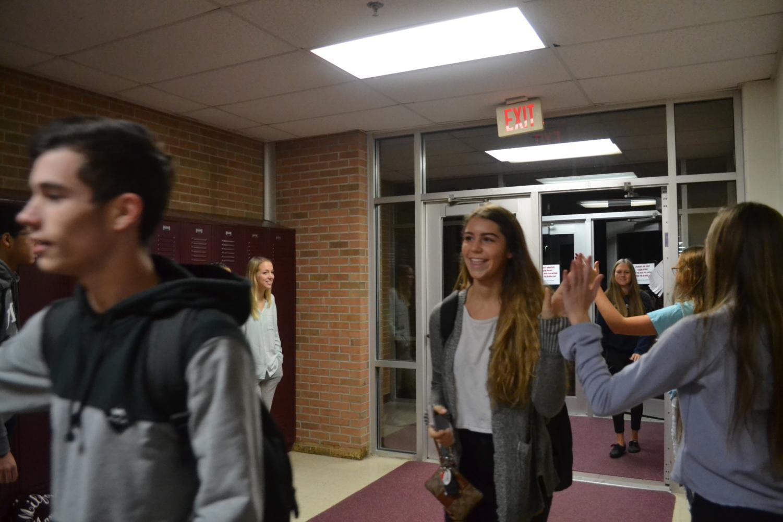 Juniors Sabrina Sajdak and Abby Spindler greeted at student parking lot entrance.