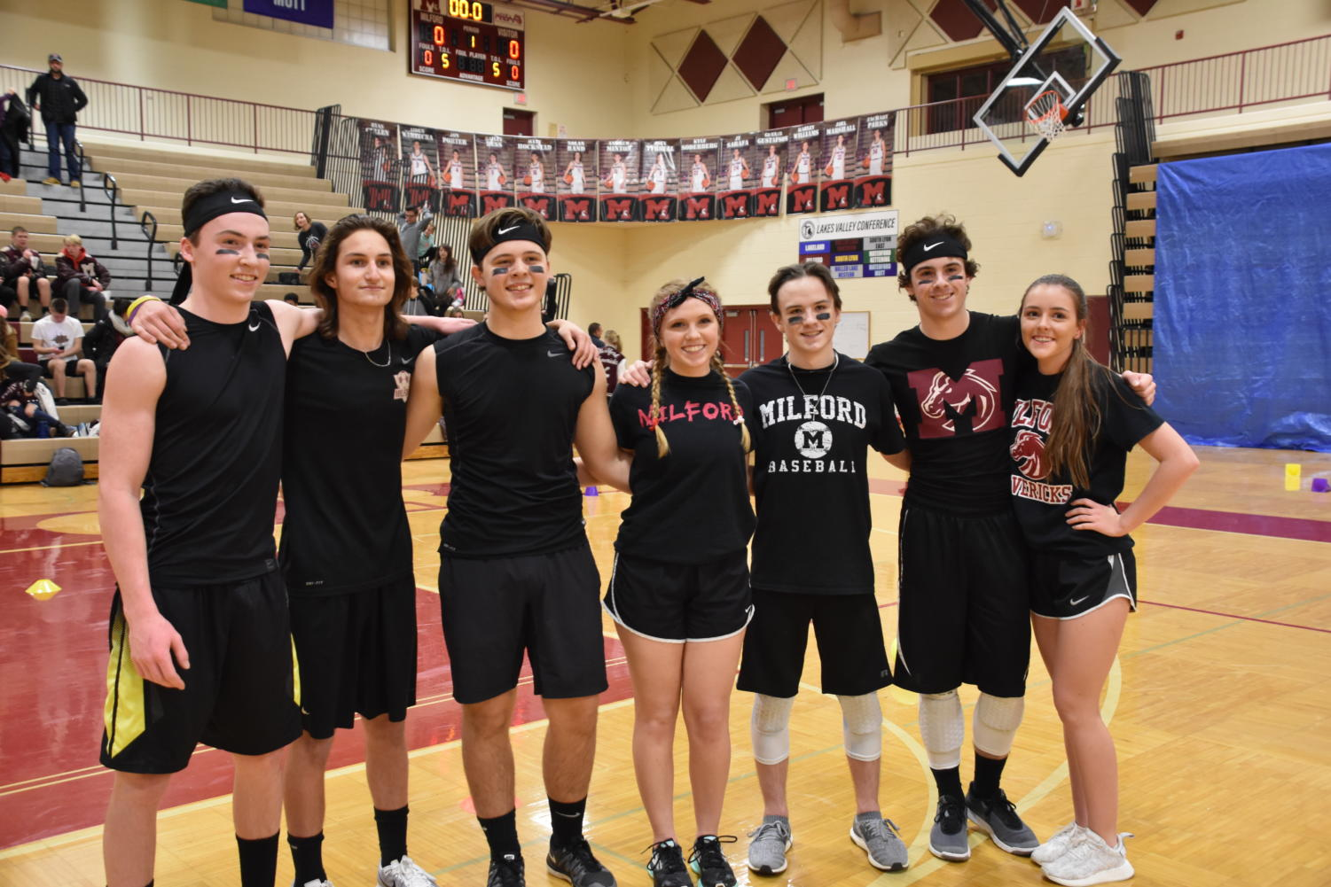 """Hard Targets,"" posing after their win. (Left to Right) Chance Murray, Steven Gillingham, Tyler Knapp, Natalie Deland, Spencer O'Neil, Dylan Riggs and India Kenhard"