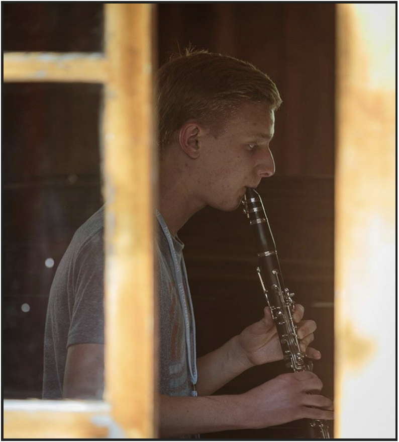 Pike performing his clarinet and working hard