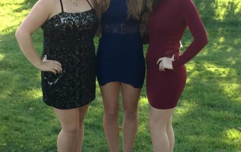 Left to Right: Senior Janna Duncan, senior Katie Lakkides, and senior Megan Miller at the Milford High School Homecoming. (Photo Courtesy of Brian  Lakkides.)