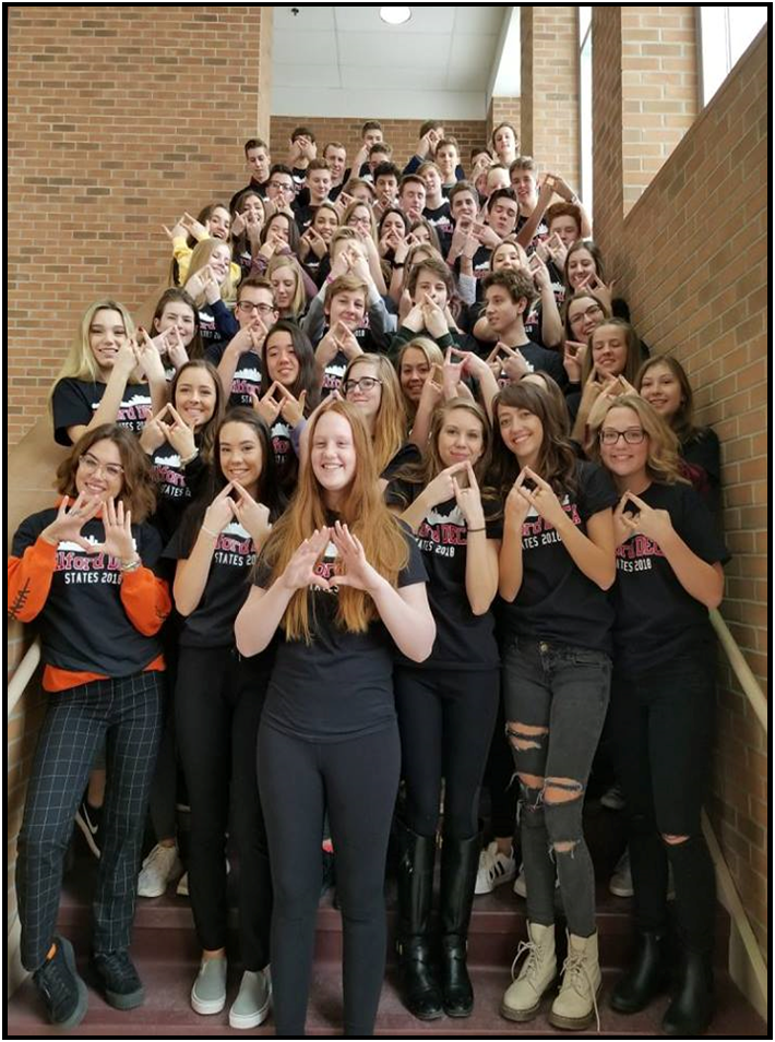 DECA students flashing the DECA diamond before states.