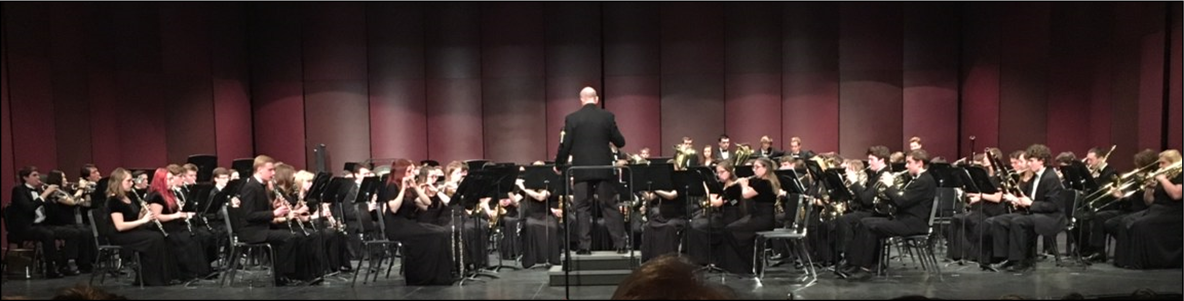 Conductor Jim Otto conducting combined wind ensembles.