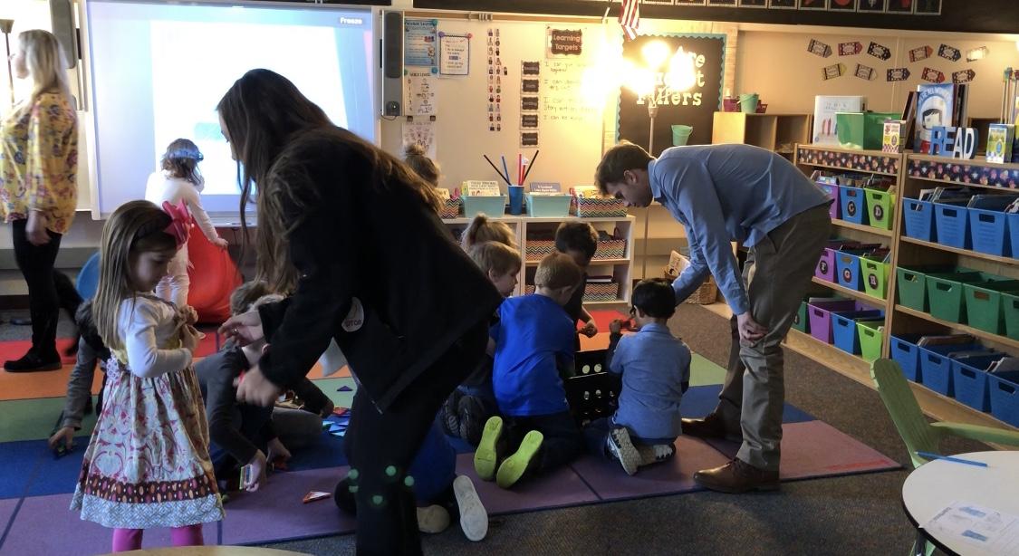 Junior Kayla Pennebaker (left) and senior Trevor Hoppe (right) spending the day working with kindergarteners at Johnson Elementary. (Photos by Abby Knapp)