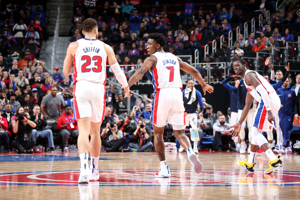 Blake Griffin and Stanley Johnson of the Pistons  high five in a game against the Suns (Image courtesy of the Detroit Pistons website).