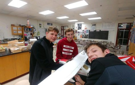 Left to right) Evan Thompson, Dylan Hoorn, and Nick Blanchard working on an aircraft