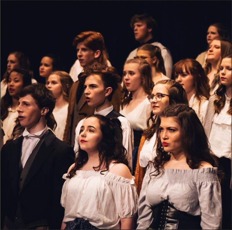 The+2019+Varsity+choirs+performs+in+the+annual+POPs+concert+%28Photo+courtesy+of+Tara+Johnson%29%0A