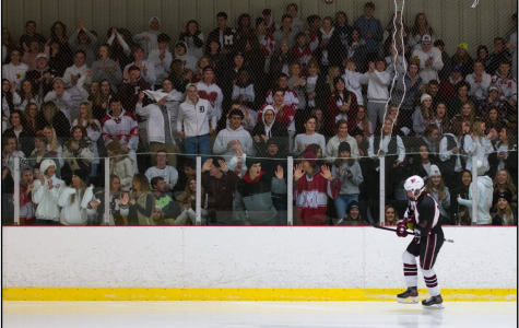 Hockey student section goes crazy as Pierce Ashcroft skates past
