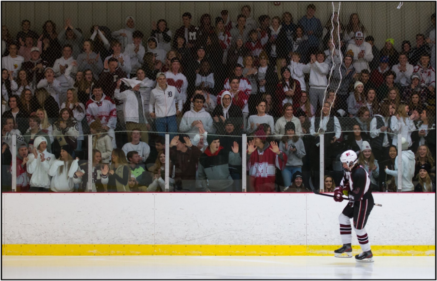 Hockey+student+section+goes+crazy+as+Pierce+Ashcroft+skates+past