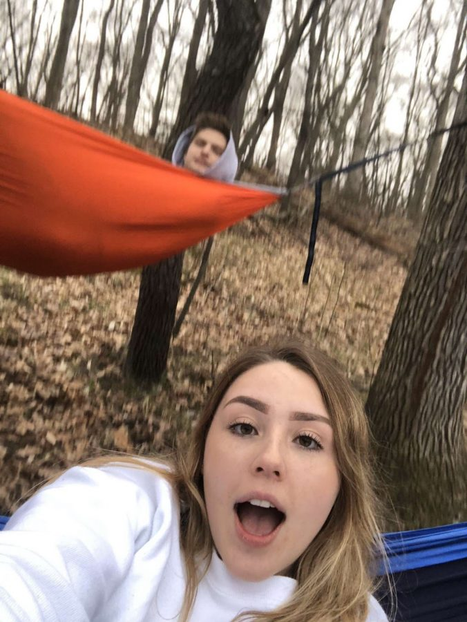 Senior+couple+Abbie+Kozel+and+Coby+Hutter+are+trying+their+best+to+stay+connected+during+the+statewide+lockdown.+Here+they+are+practicing+social+distancing+hammocking.+