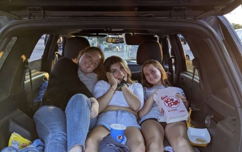 (Left to right) MHS seniors Tess Wyniemko, Aspen Snyder, and Sadie Guffy enjoying a movie at the Plymouth Summer Drive-In.