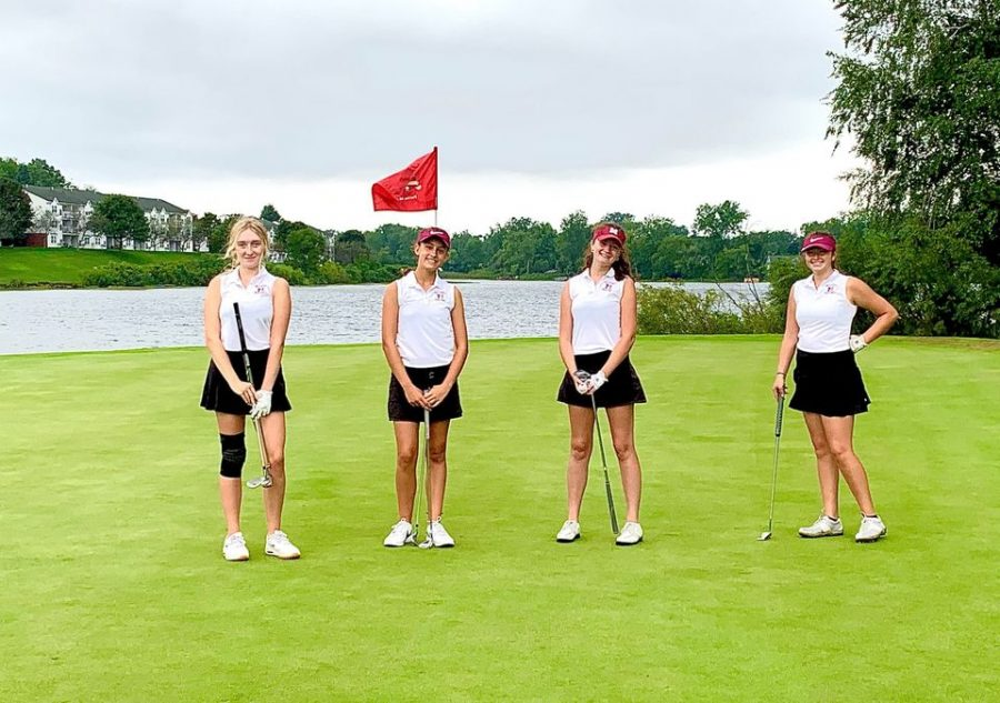 (Left to right) Senior Devin Chaldecott, sophomore Caroline Colt, senior Sadie Guffy and sophomore Ava Moore at the Oakland County Tournament at The Links at Crystal Lake.