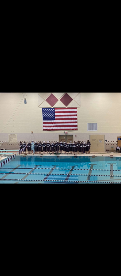 The MHS swimmers and divers all locked arms for the National Anthem during the home meet.