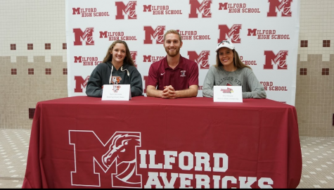 From left to right: Senior Rylie Kennedy, Coach James Schuler, and Senior Ella Glaspie posed during their signing periods at MHS, celebrating their commitments to swim at BGSU (Kennedy) and ISU (Glaspie).