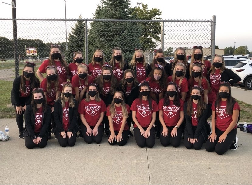Depicted above is the 2020-2021 Varsity Pom team at the first home game.