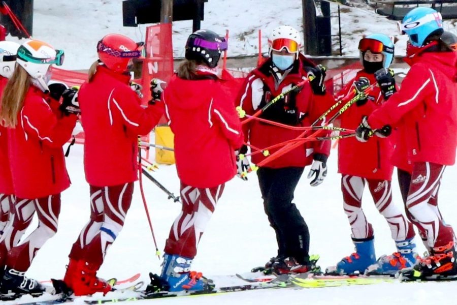 The Mavs go over inspection plans at the bottom of the hill (Photo courtesy of Resa Abbey).