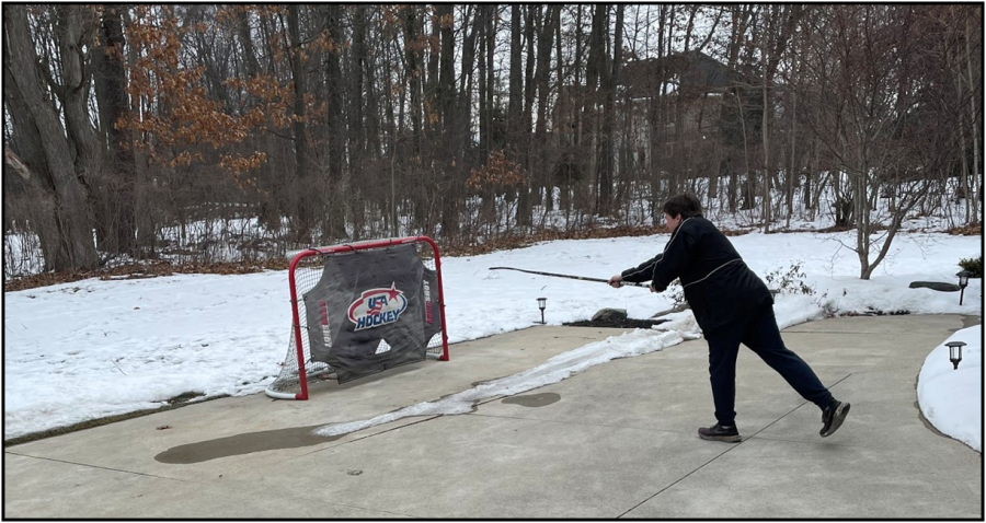 Raya getting shots in his driveway to prepare for the season that he is unsure he will have (Photo by Caleb Holmes-McGahan).