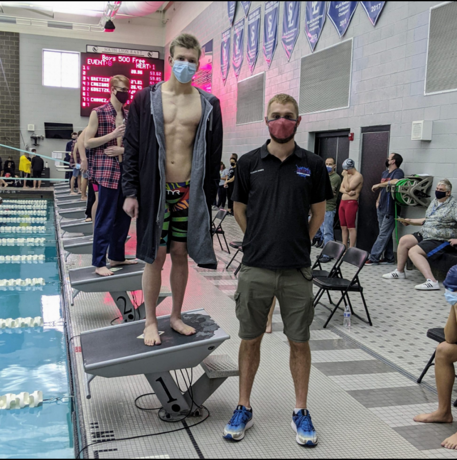Junior Fletcher Smith and Head Coach James Schuler at South Lyon East this season. Smith has qualified to race at the state meet in March (Photo courtesy of Coach James Schuler).