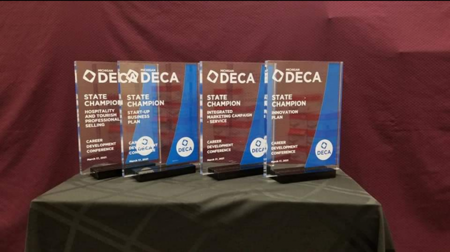 Many+DECA+members+won+medals+for+their+achievements%2C+and+state+champions+won+DECA+glass+to+commemorate+their+achievement+and+potential+to+compete+at+the+international+level+%28Photo+courtesy+of+Kaye+Sommer%29.++