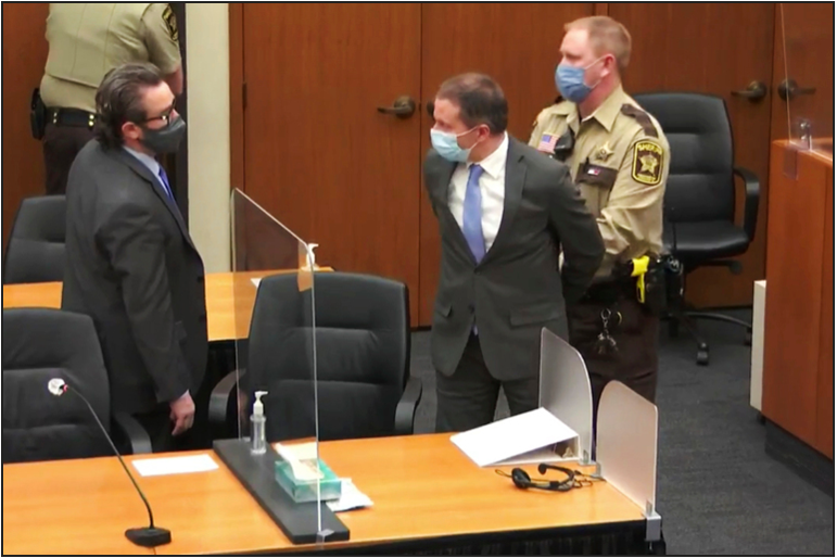 Chauvin being handcuffed and escorted out of the courtroom after the verdict was announced.