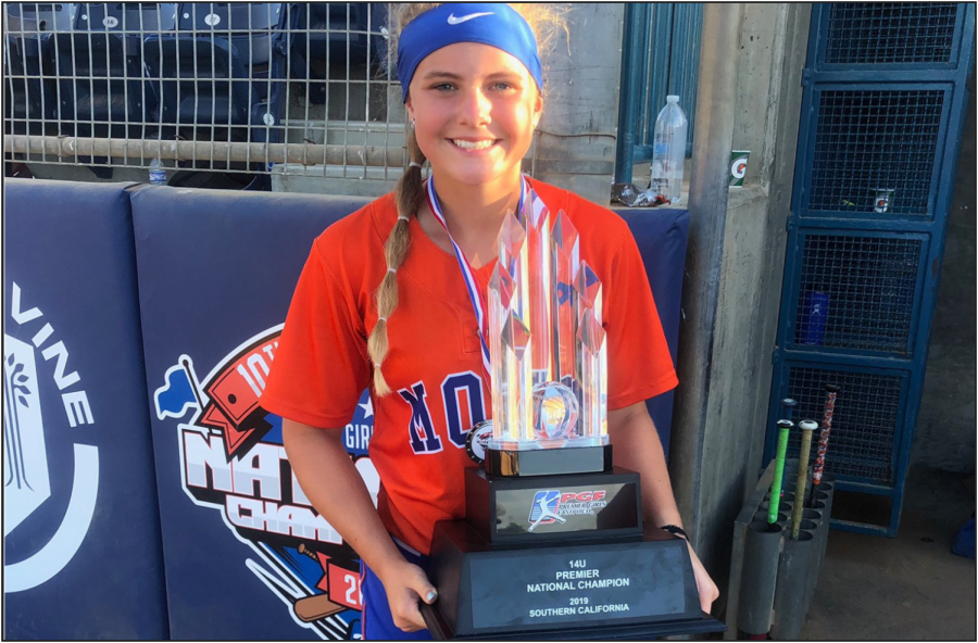 Taylor+Pannell+stands+with+the+PGF+14U+National+Tournament+trophy.