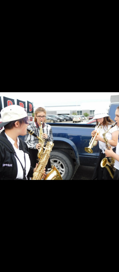 MHS band members gathered outside Walled Lake Northern High School before a performance  at an away football game (Photo courtesy of Keeley Boynton).